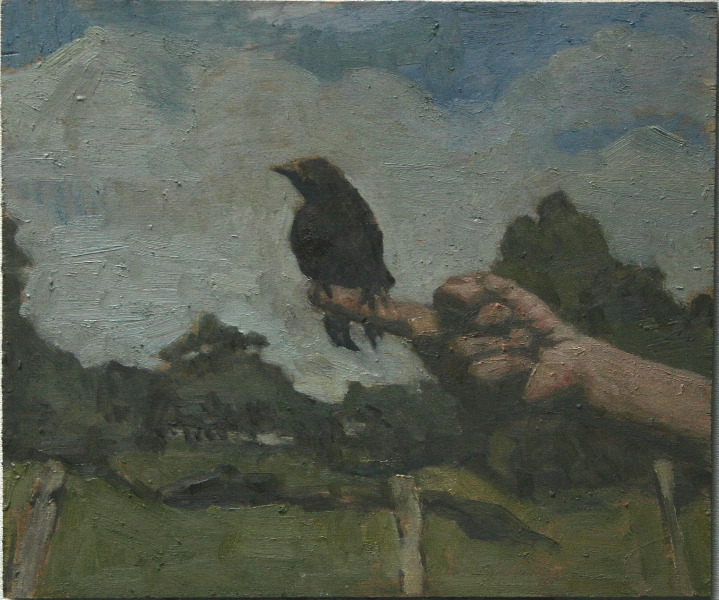 the-artists-hand-with-a-young-crow